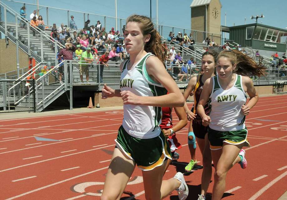 Awty junior Isabelle Grant, from left, and freshman teammate Christina Moreno compete in the Girls 1600 Meter Run at the TAPPS 4A South Regional Track Meet at Awty School. Freelance photo by Jerry Baker Photo: Jerry Baker, Freelance