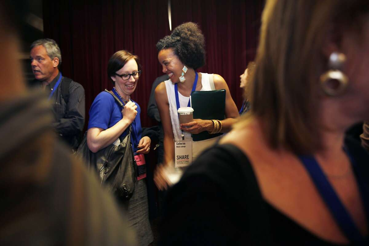 Kate Westmoreland (left) and Nkolo Lebongo chat before a session at the conference on the sharing economy.