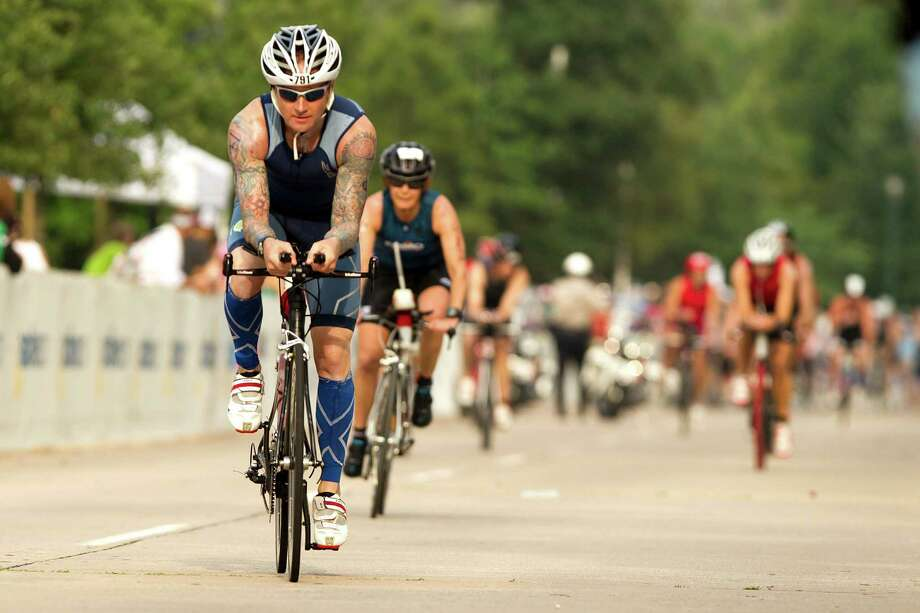 Todd Crandell started the cycling portion of last year's Memorial Hermann Ironman Texas. Around 25,000 people are expected to attend this year's event, which is set for Saturday. Photo: Brett Coomer, Staff / © 2013 Houston Chronicle