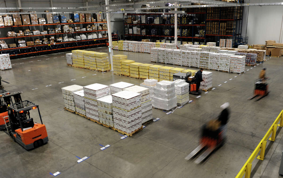 The warehouse was in full production at Railex in Rotterdam, New York where the NYS Labor Department spoke about new initiatives that have been designed to help business in the Capital Region to weather the economic storm. (Skip Dickstein / Times Union)