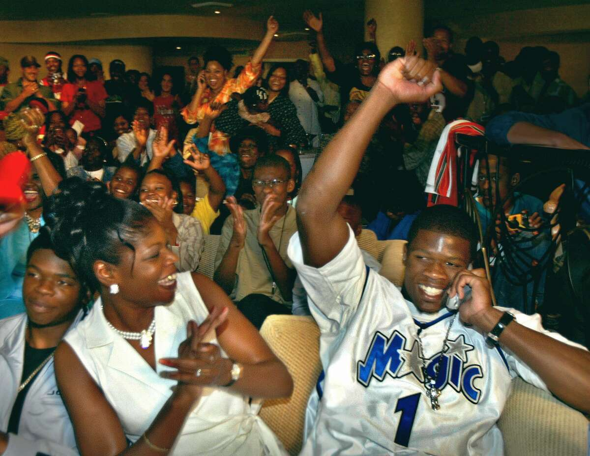 Miami's Andre Johnson, right, celebrates with his mother, Karen Johnson, as he is selected by the Houston Texans with the third overall pick in the NFL draft Saturday, April 26, 2003, in Miami. Johnson watched the selection process with family and friends at the Mayfair Hotel in Miami.