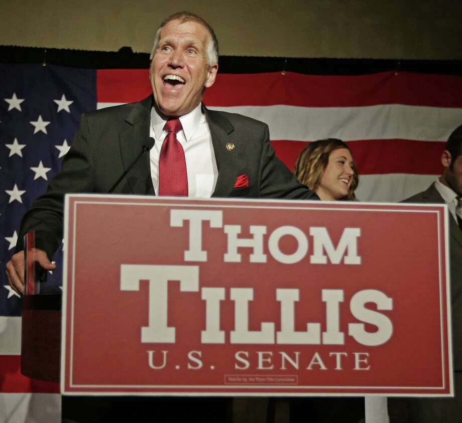 Thom Tillis speaks at an election night rally in Charlotte, N.C., after winning the Republi-can nomination for the U.S. Senate. Tillis, the GOP establishment-favored son in North Carolina, was endorsed by the NRA and National Right to Life but was attacked by the tea party as not conservative enough. Photo: Chuck Burton / Associated Press / AP
