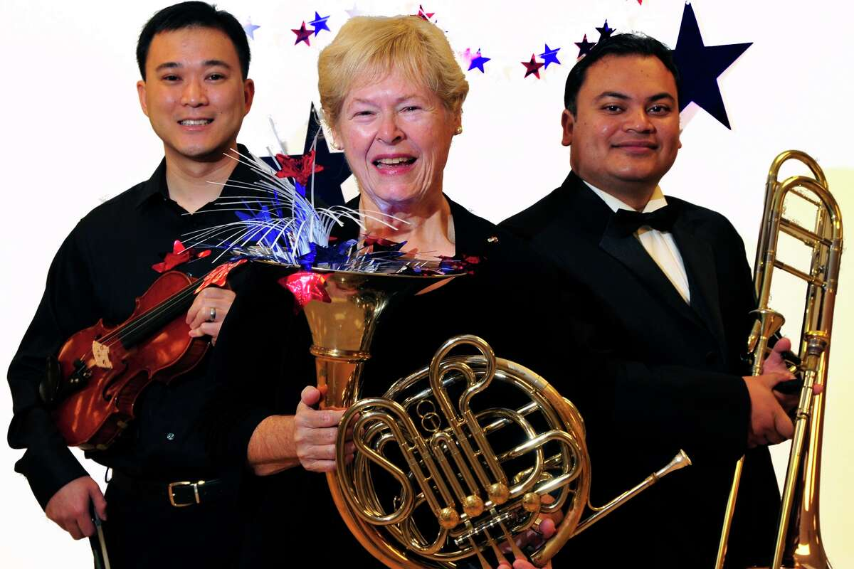 Ready for their season-closer of American music are Fort Bend Symphony Orchestra musicians Daniel Hung, violin; Cynthia Whitty, French horn; and David Flores, trombone.