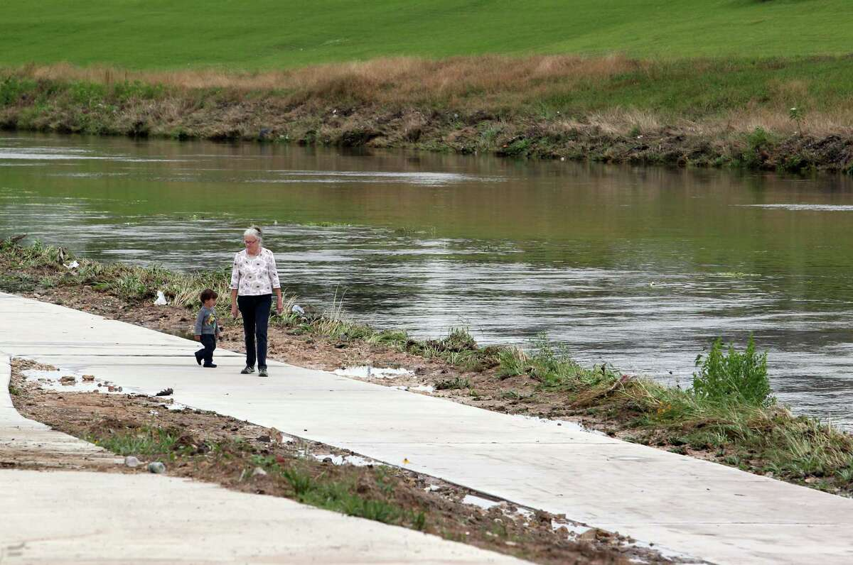 Sally Lehr with her grandson two year-old Matteo Salazar walk along Brays Bayou in the community of Idylwood in Houston's east end Tuesday, May 13, 2014.