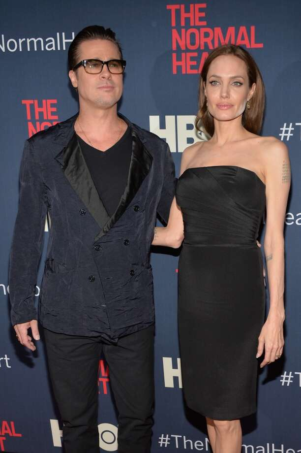 "Brad Pitt and Angelina Jolie attend the New York premiere of ""The Normal Heart"" at Ziegfeld Theater on May 12, 2014 in New York City. Photo: Ben Gabbe, Getty Images"