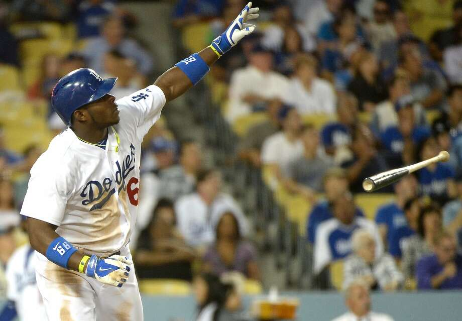 The Dodgers' Yasiel Puig, reacting to a homer against the Marlins on Monday night, comes from a culture in which ballgames are a canvas for unbridled self-expression. Photo: Harry How, Getty Images