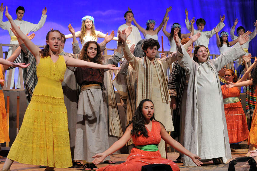 The ensemble comes together to finish the opening scene of the second act during the dress rehearsal performance of