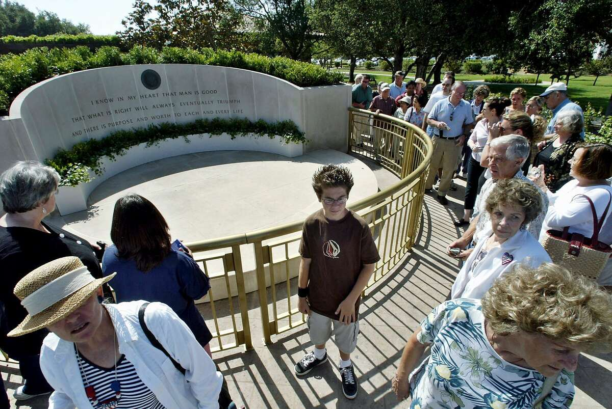TRAVEL SIMI VALLEY, Calif. -- Visitors view the memorial site of former President Ronald Reagan in this file photo taken Monday, June 14, 2004, at the reopened Ronald Reagan Presidential Library in Simi Valley, Calif. The recent scene at the library exemplifies the ongoing challenge of the nation's dozen presidential libraries as they compete for visitors in a world full of theme parks and other attractions. (AP Photo/Ric Francis, File)
