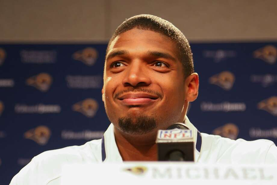 Seventh-round draft pick Michael Sam answers reporters' questions at the Rams' headquarters in suburban St. Louis. Photo: Dilip Vishwanat, Getty Images