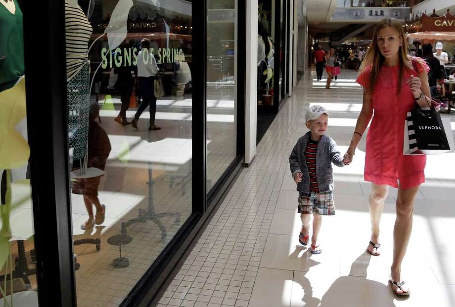Anneka Johnson shops with her son at the Aventura Mall in Aventura, Fla. April retail sales rose slightly. Photo: Lynne Sladky, STF / AP