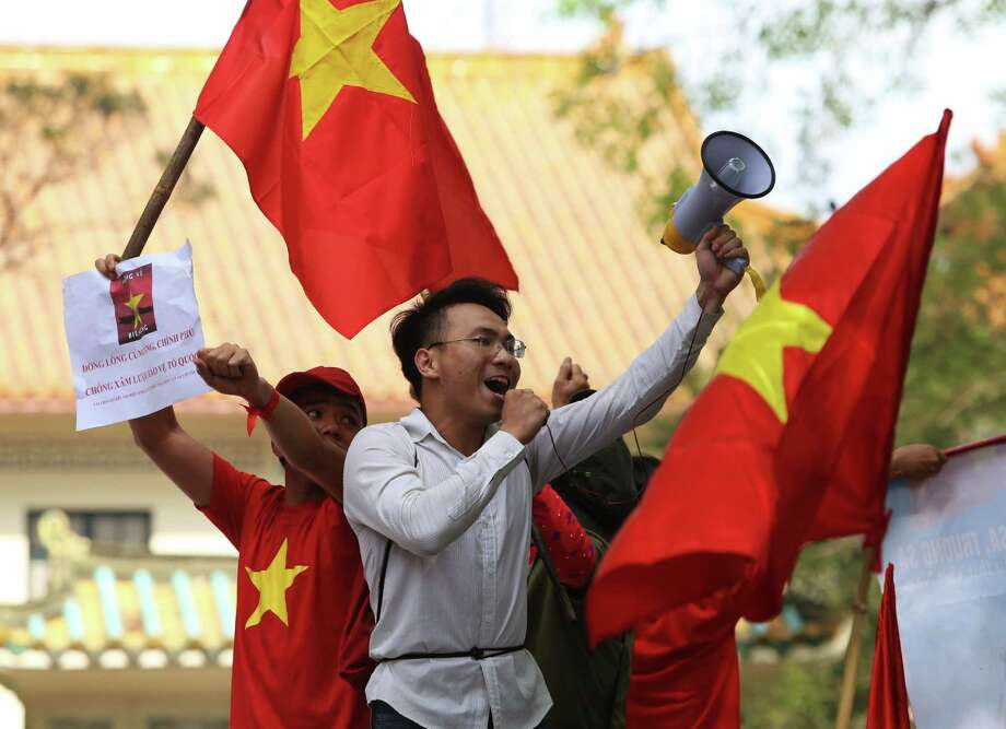 Anti-China protesters demonstrate near the Chinese Embassy in Hanoi over the weekend. On Monday and Tuesday, the protests spread to factories. Photo: MAI KY, Stringer / AFP