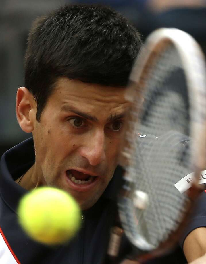 Keeping his eye on the ball - and racket - Novak Djokovic hits a return during his victory over Radek Stepanek in Rome. Photo: Alessandra Tarantino, Associated Press