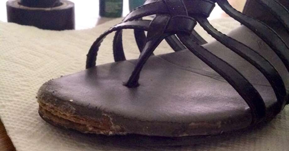 I scuff my feet when I walk, so my shoes payed the price, the front of them coming apart and being sanded down by the pavement. Photo: Courtney N. M.