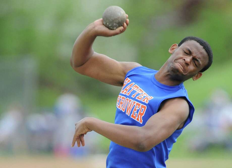 Danbury's Michael Reid competes in the shotput at the high school boys track and field meet between Danbury, Greenwich and Bridgeport Central at Danbury High School in Danbury, Conn. Tuesday, May 13, 2014. Photo: Tyler Sizemore / The News-Times