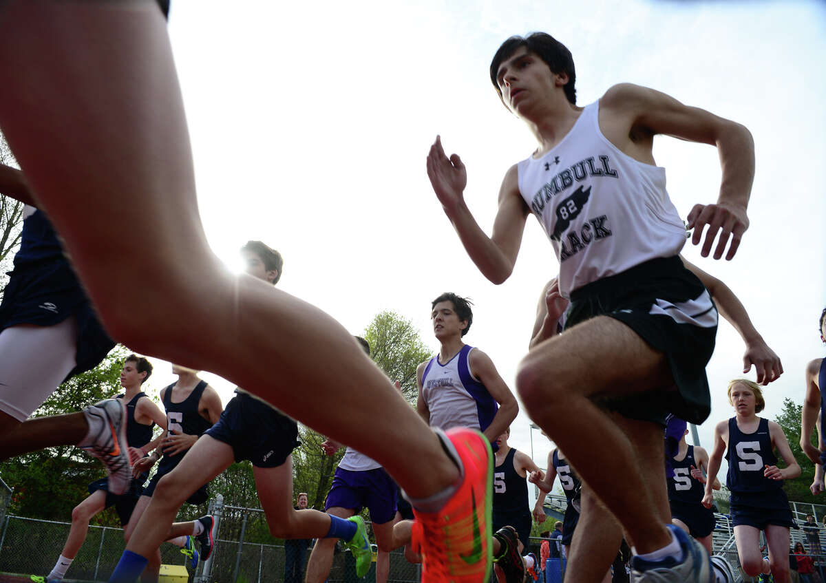 Trumbull's Charlie Taubl takes off from the starting line in the 1600 meter race, during boys track action against Westhill and Staples in Trumbull, Conn. on Tuesday May 13, 2014.