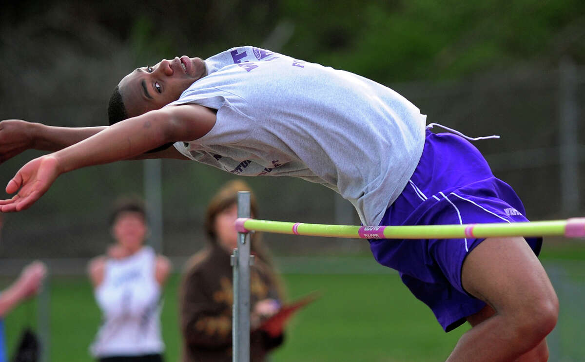 Westhill's Carl Gedeon competes in the high jump, during boys track action against Trumbull and Staples in Trumbull, Conn. on Tuesday May 13, 2014.