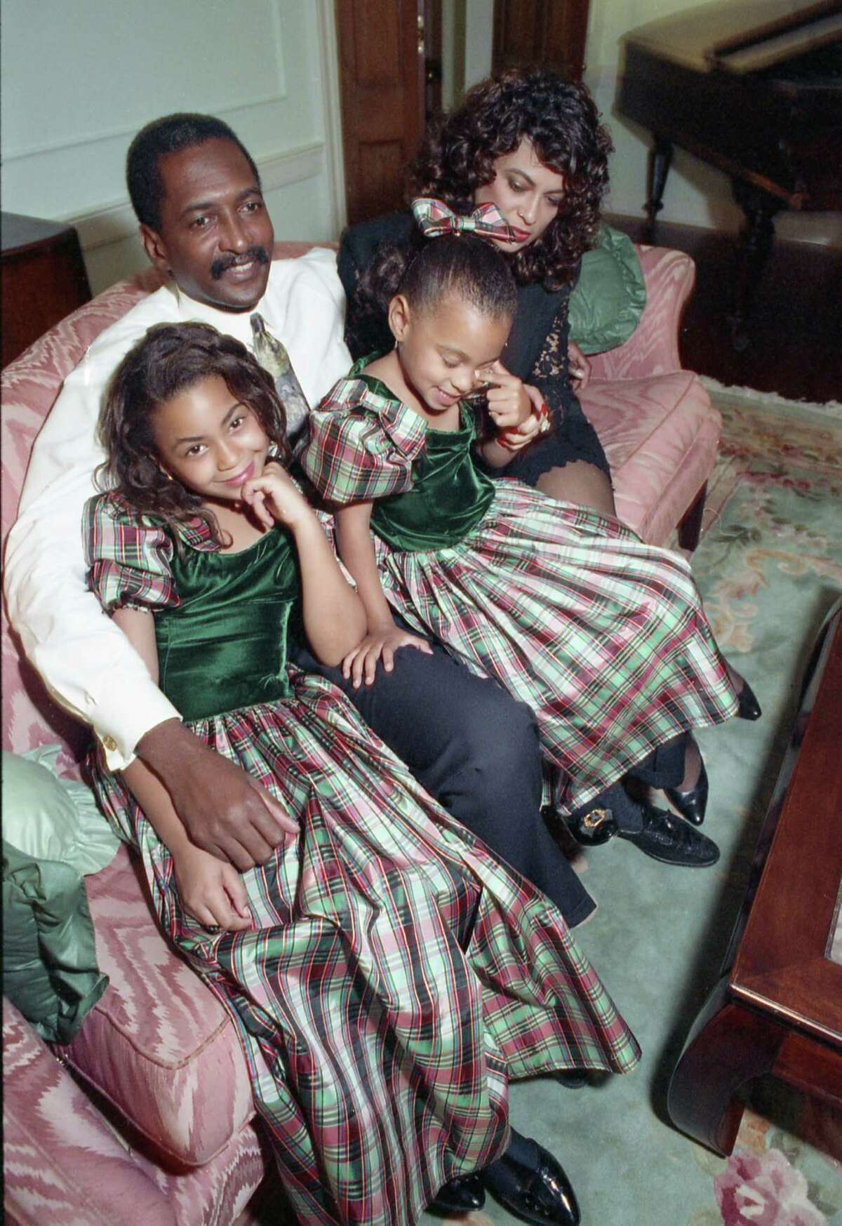 Tina & Mathew Knowles, with their two daughters, Beyonce and Solange.