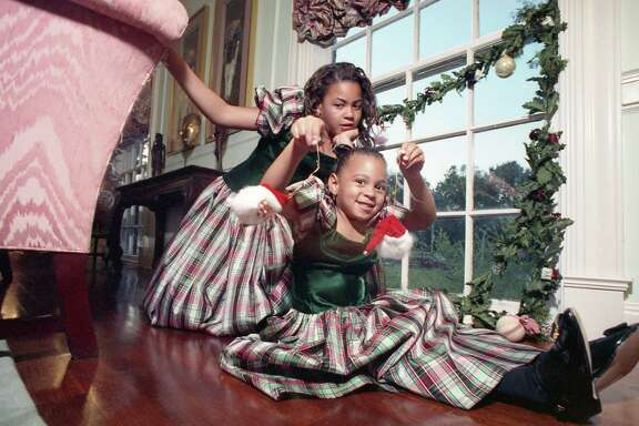 10/23/1990 - Family Christmas traditions. Tina & Mathew Knowles, with their two daughters, Beyonce and Solange.