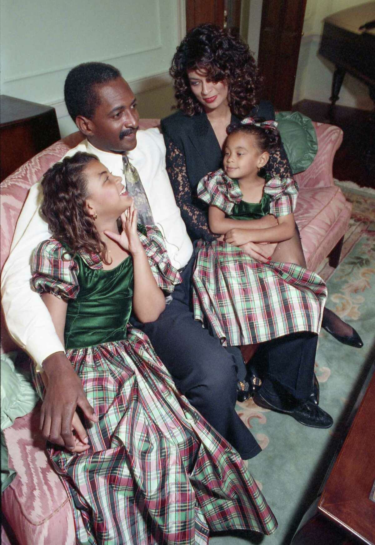 Tina & Mathew Knowles, with their two daughters, Beyonce and Solange, 1990.