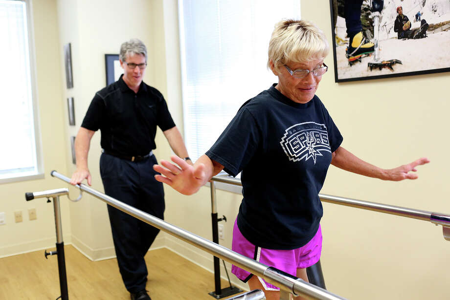 Prosthetist/Orthotist Kirk Simendinger watches patient Alma Bryand walk after he made some changes to improve the fit for the socket of her prosthetic leg at Bulow Orthotic & Prosthetic Solutions in San Antonio on Monday, May 12, 2014. Photo: SAN ANTONIO EXPRESS-NEWS / SAN ANTONIO EXPRESS-NEWS