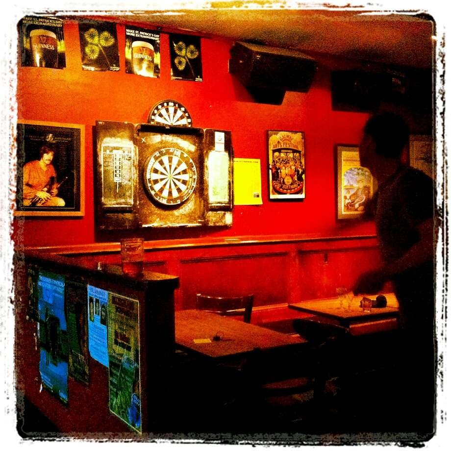 9 May, 10:48 p.m.: Hello, Friday. Darts at the Plough & Stars Pub on Clement Street. Photo: Catherine Bigelow, Special To The Chronicle
