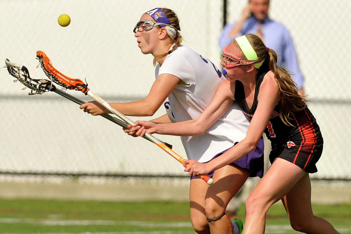 Westhill's Nicole Senerchia and Stamford's Jenn Kruppa compete for the loose ball during their lacrosse game at Westhill High School in Stamford, Conn., on Tuesday, May 13, 2014. Stamford won, 18-2.