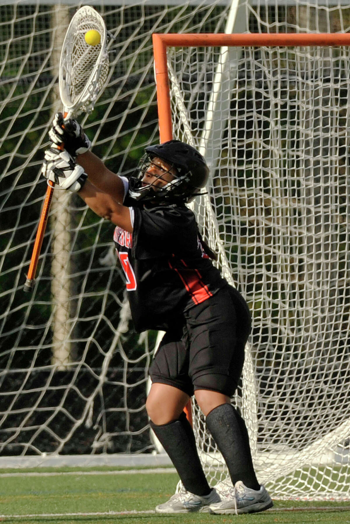 Stamford goalie Lesly Sanchez makes a save during the Black Knights' lacrosse game against Westhill at Westhill High School in Stamford, Conn., on Tuesday, May 13, 2014. Stamford won, 18-2.
