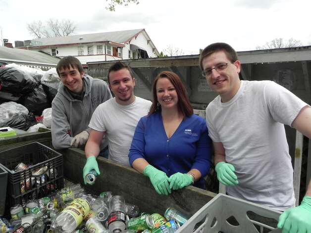 Community Resource Federal Credit Union?s employees collected 12,200 cans and bottles during their bottle drive for Mohawk Hudson Humane Society on Saturday, May 3. The employees also sorted the bottles at the Humane Society. From left are Jeff Gallo, Jonathan DiMaria, Kira Quintana and Kevin Hoag. (Wendy Meola)