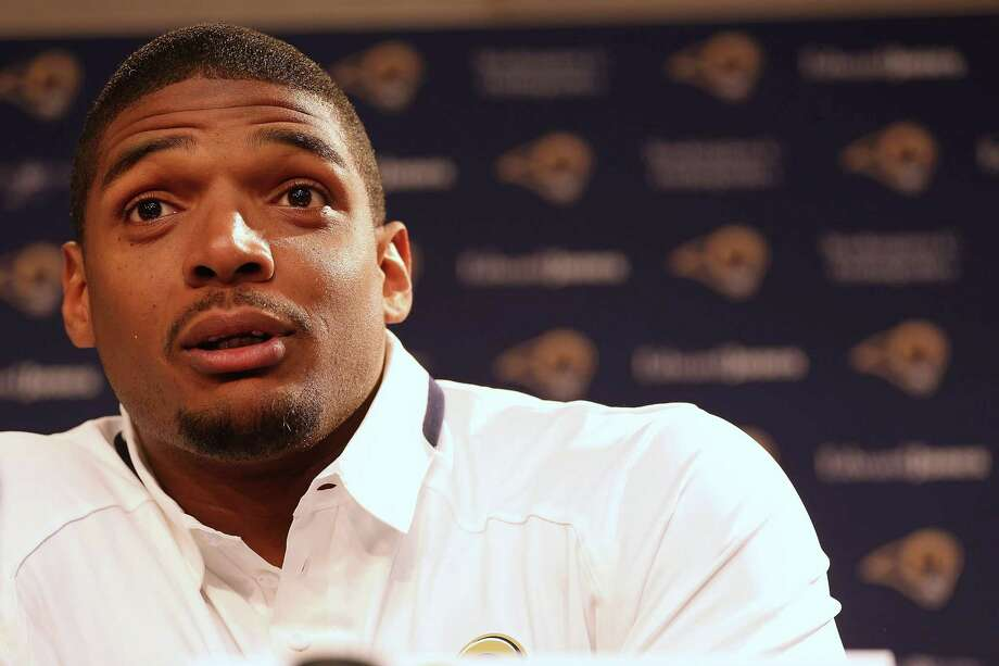 EARTH CITY, MO - MAY 13: St. Louis Rams draft pick Michael Sam addresses the media during a press conference at Rams Park on May 13, 2014 in Earth City, Missouri.  (Photo by Dilip Vishwanat/Getty Images) ORG XMIT: 490607539 Photo: Dilip Vishwanat / 2014 Getty Images