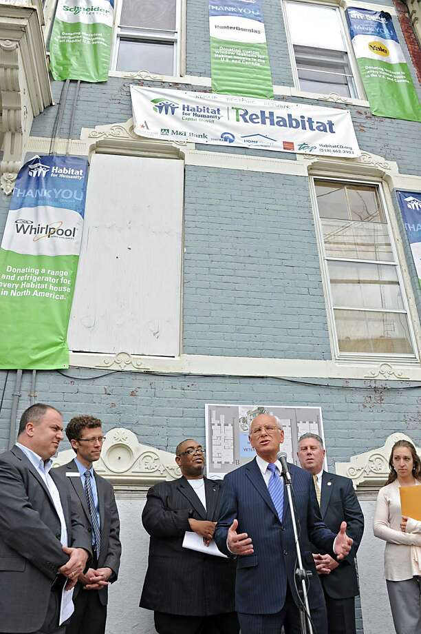 Congressman Paul Tonko speaks during a press conference at 126 Lark St. where Habitat for Humanity Capital District announced its new initiative, ReHabitat, to fight blight and revitalize neighborhoods Tuesday, May 13, 2014, in Albany, N.Y.  (Lori Van Buren / Times Union) Photo: Lori Van Buren / 00026850A