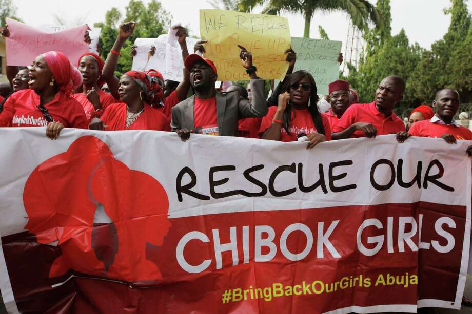 """Women attend a demonstration calling on the government to rescue the kidnapped schoolgirls of the Chibok secondary school, in Abuja, Nigeria, Tuesday, May 13, 2014. A Nigerian government official said """"all options are open"""" in efforts to rescue almost 300 abducted schoolgirls from their captors as US reconnaissance aircraft started flying over this West African country in a search effort.  Boko Haram, the militant group that kidnapped the girls last month from a school in Borno state, had released a video yesterday purporting to show some of the girls. A civic leader said representatives of the missing girls' families were set to view the video as a group later today to see if some of the girls can be identified. (AP Photo / Sunday Alamba) Photo: Sunday Alamba, STF / AP"""