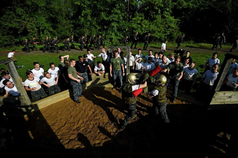 Members of the United States Naval Academy freshman class fight with pupil sticks during the annual Sea Trials training exercise at the U.S. Naval Academy on May 13, 2014 in Annapolis, Maryland. Photo: Patrick Smith, Getty Images / 2014 Getty Images