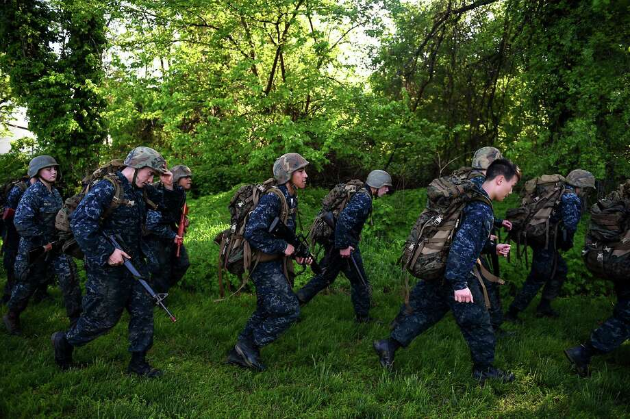 Members of the United States Naval Academy freshman class ruck run during the annual Sea Trials training exercise at the U.S. Naval Academy on May 13, 2014 in Annapolis, Maryland. Photo: Patrick Smith, Getty Images / 2014 Getty Images