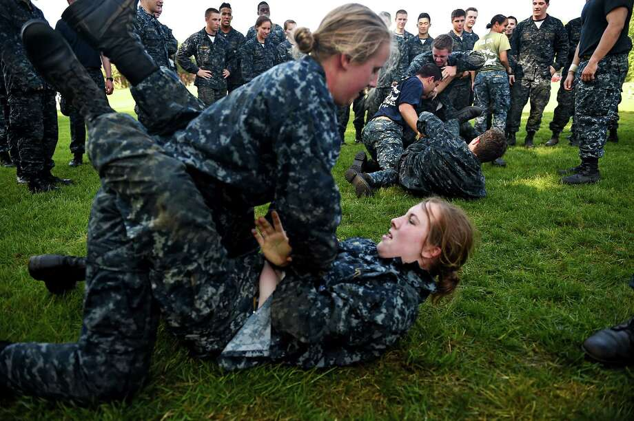 Members of the United States Naval Academy freshman class ground fight during the annual Sea Trials training exercise at the U.S. Naval Academy on May 13, 2014 in Annapolis, Maryland. Photo: Patrick Smith, Getty Images / 2014 Getty Images