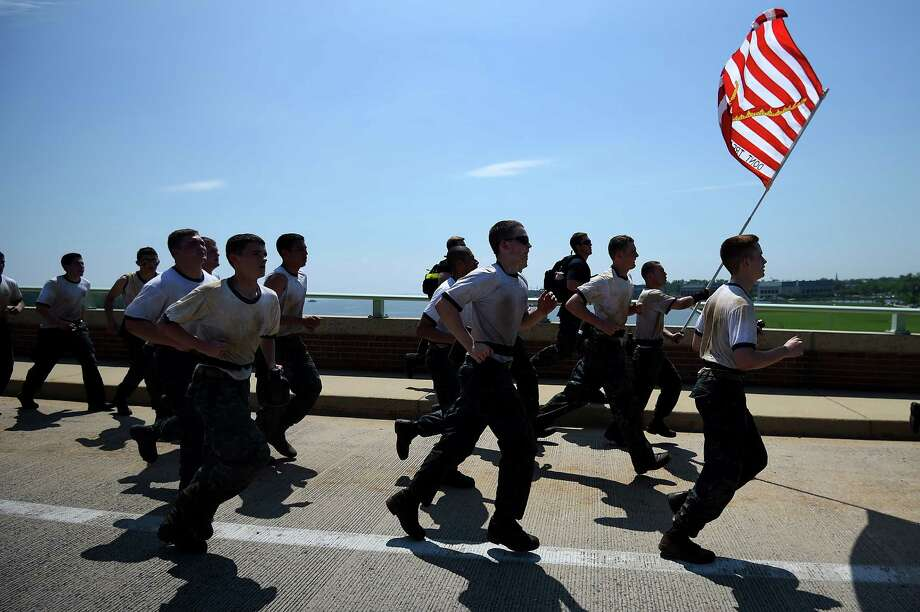 Members of the United States Naval Academy freshman class run over a bridge during the annual Sea Trials training exercise at the U.S. Naval Academy on May 13, 2014 in Annapolis, Maryland. Photo: Patrick Smith, Getty Images / 2014 Getty Images