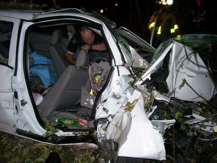 Police investigate the wreckage of a Chevrolet Cobalt that crashed in the fall of 2006 in St. Croix County, Wis., killing two teenagers. The air bags didn't deploy, a problem that may be linked to a defective ignition switch. Photo: Uncredited, HOPD / St. Croix County Sheriff's Offic