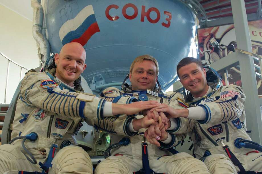 The next expedition to the International Space Station is set to take off from Kazakhstan's Baikonur cosmodrome on May 28. Its crew members include, from left, European Space Agency's German astronaut Alexander Gerst, Russian cosmonaut Maxim Suraev and U.S. NASA astronaut Gregory Wiseman. Photo: -, Stringer / AFP