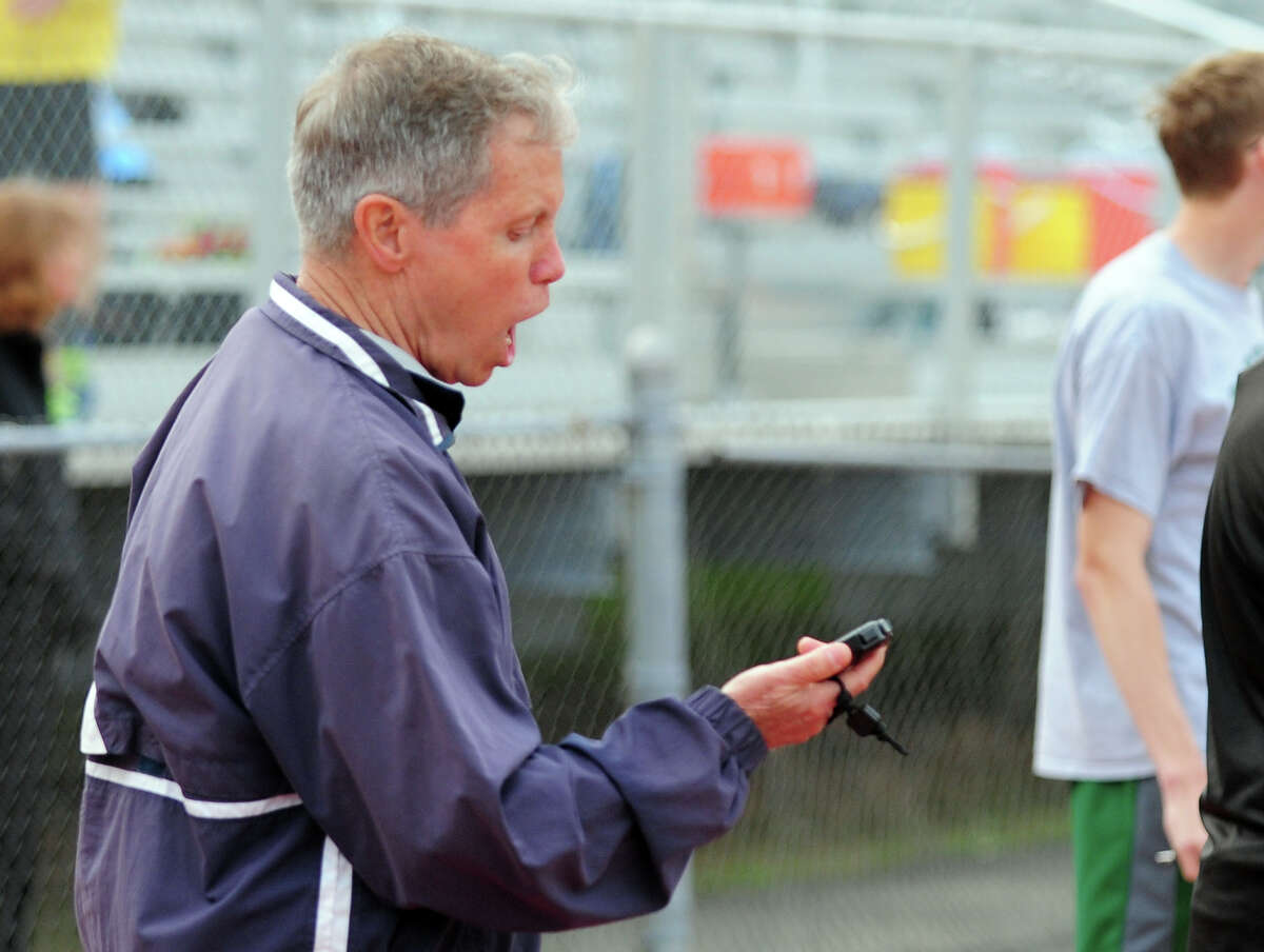 Staples' Track Coach Laddie Lawrence, during boys track action against Westhill and Trumbull in Trumbull, Conn. on Tuesday May 13, 2014.