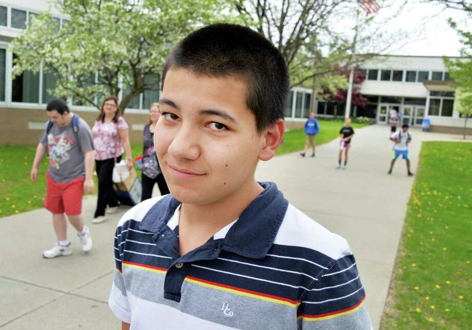 James Villeneuve, a 15-year-old Shaker High student, found a bag of money at the Tulip Festival last weekend. The money - $4,500 - was left in a CVS bank deposit bag so he returned it to the store. They gave a him a $20 gift certificate. (John Carl D'Annibale / Times Union) Photo: John Carl D'Annibale / 00026860A