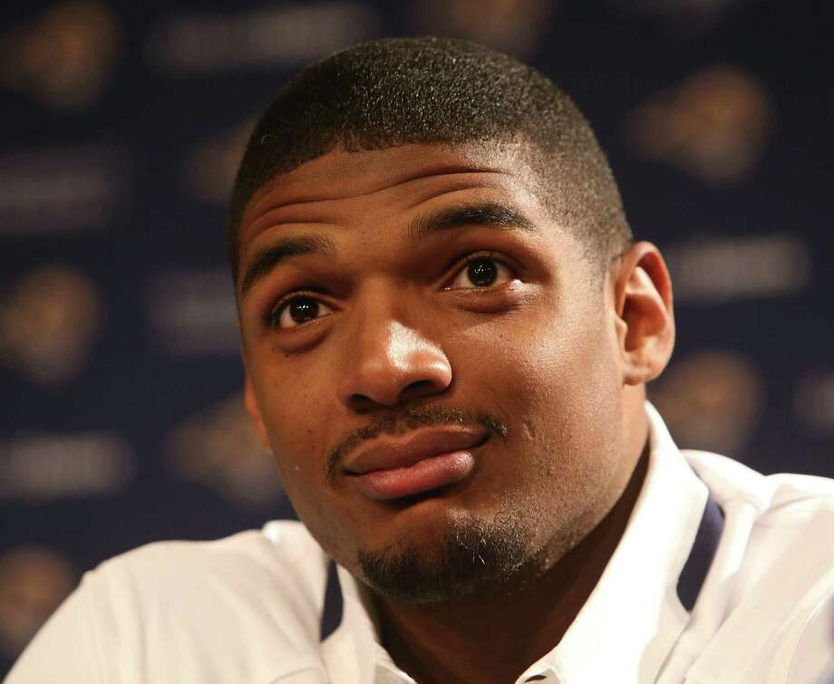 St. Louis Rams defensive end Michael Sam attends an introductory press conference on Tuesday, May 13, 2014, at Rams Park in Earth City, Mo. (Chris Lee/St. Louis Post-Dispatch/MCT) Photo: Chris Lee, MBR / St. Louis Post-Dispatch
