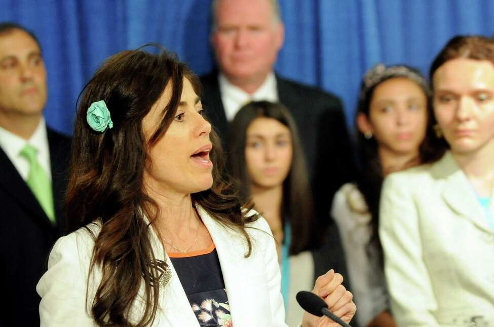 Sonia Ossorio, president of NOW NYC, left, speaks during a news conference to push for the Trafficking Victims Protection and Justice Act on May 13, 2014, at the Legislative Office Building in Albany, N.Y. (Cindy Schultz / Times Union)