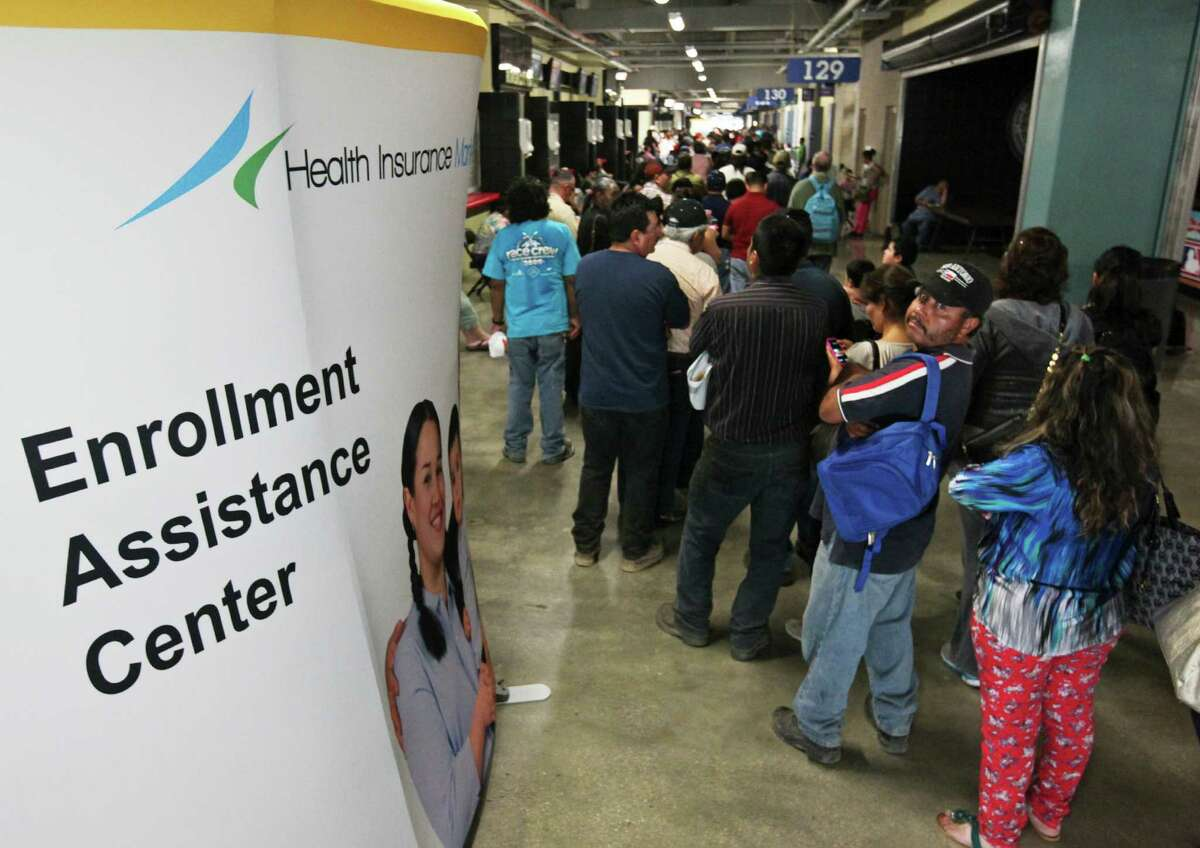 Consumers line up earlier this spring to enroll for health insurance under the Affordable Care Act at the Alamodome in San Antonio.