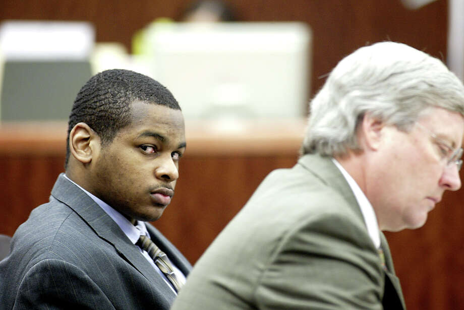 New evidence has come to light in the case of Alfred Dewayne Brown, left, with defense lawyer Robert Morrow at trial in 2005. Photo: Jessica Kourkounis, Contract / Contract