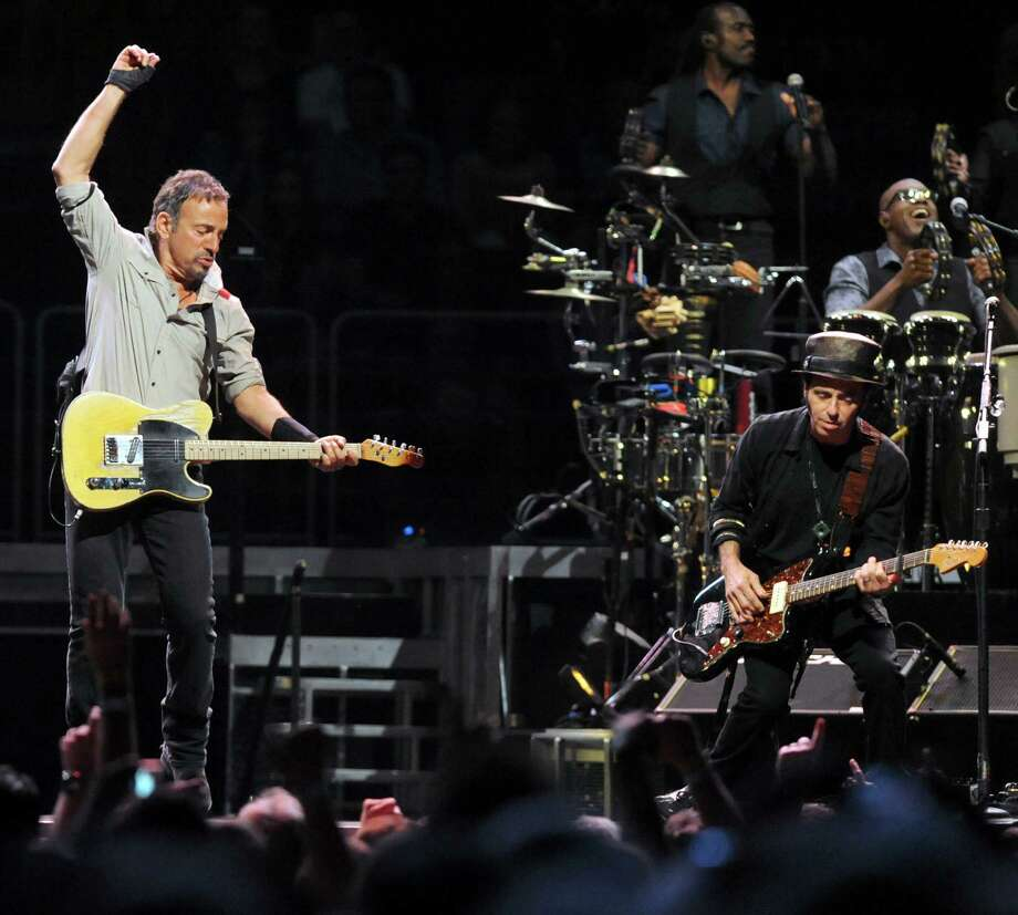Bruce Springsteen, left, and The E Street Band perform at the Times Union Center on Tuesday May 13, 2014 in Albany, N.Y. (Michael P. Farrell/Times Union) Photo: Michael P. Farrell / 00026878A