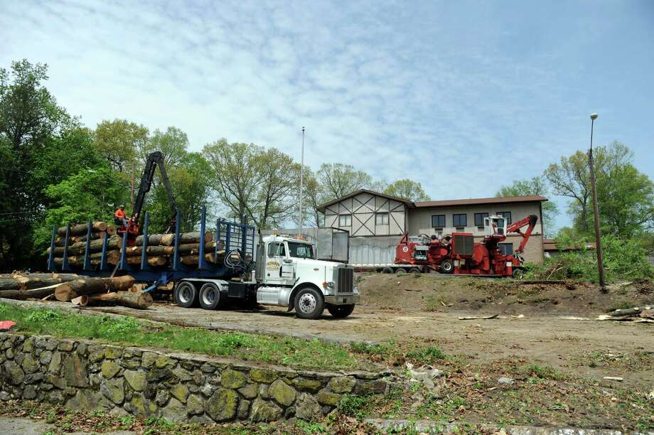 Workers clear trees on the site of the former Sons of Italy hall on New Canaan Avenue in Norwalk Tuesday, May 13, 2014 to make way for a new assisted living complex by Brightview Senior Living, LLC/ The Shelter Group/Shelter Development. Photo: Autumn Driscoll / Connecticut Post