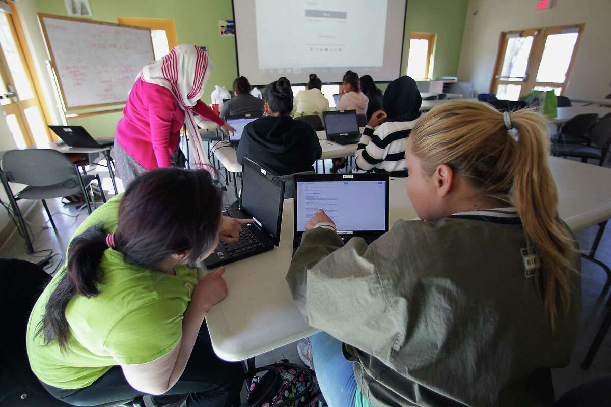 A computer class is one of the big attractions for immigrants drawn to the Baker-Ripley Neighborhood Center in Houston, where the nonprofit offers courses of instruction ranging from basic life skills to language classes to financial advice.