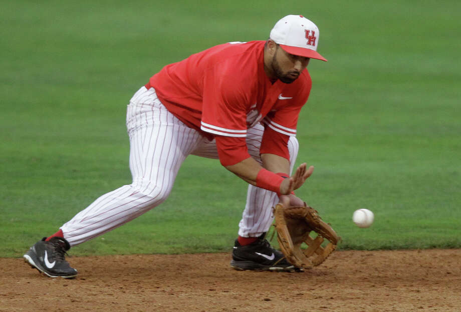 University of Houston shortstop Frankie Ratcliff fields a ball in the fourth inning during an NCAA baseball game against Rice at Constellation Field on Tuesday, May 13, 2014, in Sugar Land. Photo: J. Patric Schneider, For The Chronicle / © 2014 Houston Chronicle