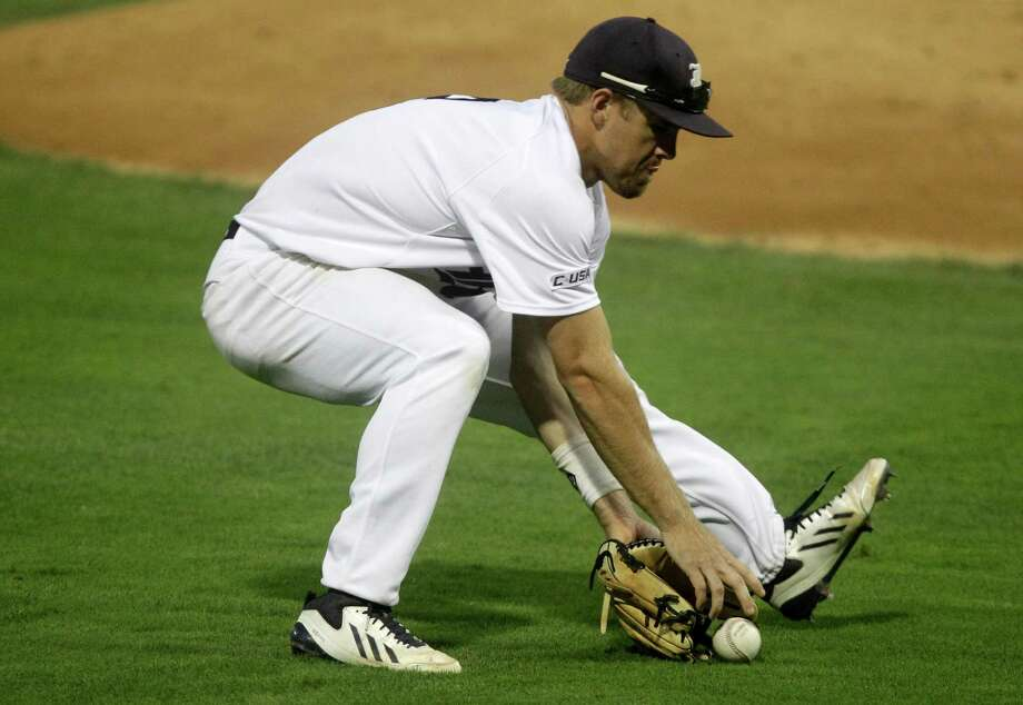 Rice third baseman Shane Hoelscher fields a ball in the fifth inning during an NCAA baseball game against the University of Houston at Constellation Field on Tuesday, May 13, 2014, in Sugar Land. Photo: J. Patric Schneider, For The Chronicle / © 2014 Houston Chronicle