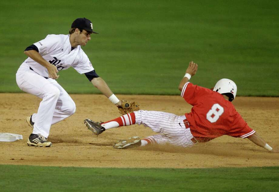 University of Houston's Josh Vidales (8) is caught stealing by Rice second baseman Connor Teykl in the seventh inning during an NCAA baseball game at Constellation Field on Tuesday, May 13, 2014, in Sugar Land. Photo: J. Patric Schneider, For The Chronicle / © 2014 Houston Chronicle