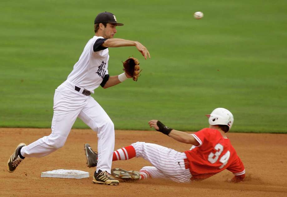 Rice second baseman Connor Teykl gets the lead runner, University of Houston's Kyle Survance, but falls short on completing the double play in the first inning during an NCAA baseball game at Constellation Field on Tuesday, May 13, 2014, in Sugar Land. Photo: J. Patric Schneider, For The Chronicle / © 2014 Houston Chronicle